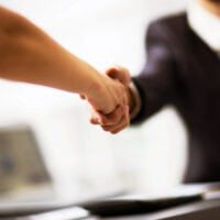 shaking hands at a meeting