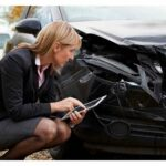 insurance adjuster looking at damages